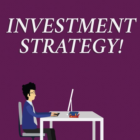 Writing note showing Investment Strategy. Business concept for the systematic plan to allocate investable assets Businessman Sitting on Chair Working on Computer and Books Reklamní fotografie