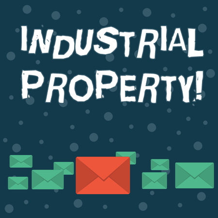 Writing note showing Industrial Property. Business concept for the intangible ownership of a trademark or patent Color Envelopes in Different Sizes with Big one in Middle Reklamní fotografie