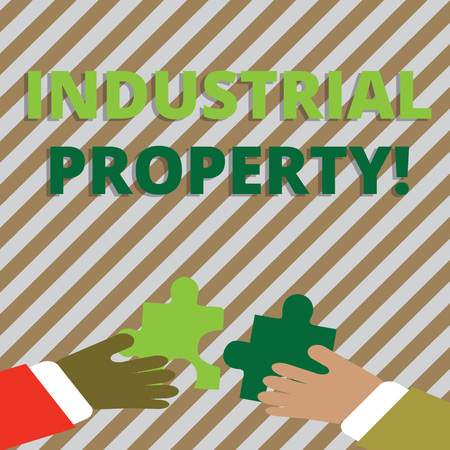 Text sign showing Industrial Property. Business photo showcasing the intangible ownership of a trademark or patent Two Hands Holding Colorful Jigsaw Puzzle Pieces about to Interlock the Tiles