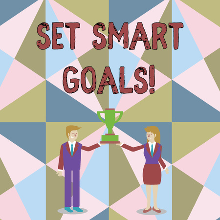 Word writing text Set Smart Goals. Business photo showcasing list to clarify your ideas focus efforts use time wisely Man and Woman in Business Suit Holding Together the Championship Trophy Cup
