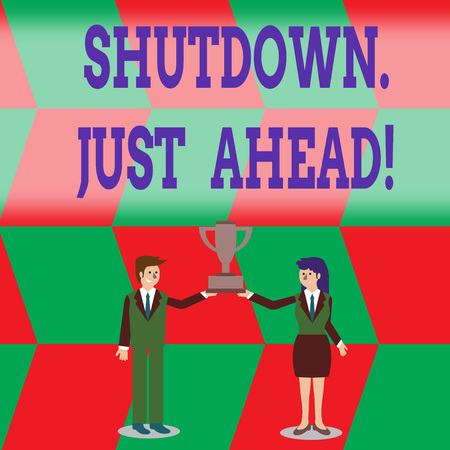 Writing note showing Shutdown Just Ahead. Business concept for closing factory business either short time or forever Man and Woman Business Suit Holding Championship Trophy Cup Stock Photo