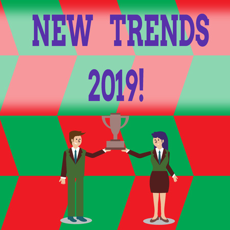 Writing note showing New Trends 2019. Business concept for general direction in which something is developing Man and Woman Business Suit Holding Championship Trophy Cup Stock fotó