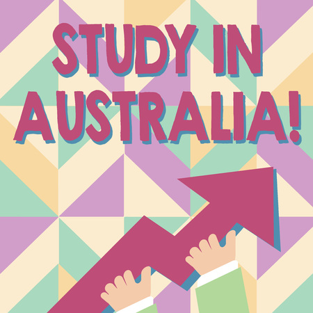 Handwriting text Study In Australia. Conceptual photo going into foreign country order complete your studies photo of Hand Holding Colorful Huge 3D Arrow Pointing and Going Up