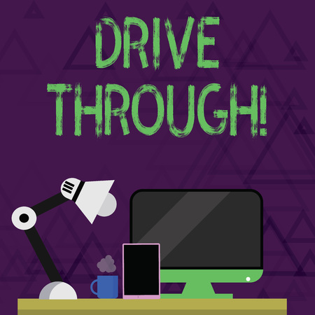 Writing note showing Drive Through. Business concept for place where you can get type of service by driving through it Arrangement for Nightshift Worker Computer, Tablet and Lamp