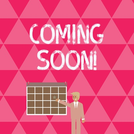 Text sign showing Coming Soon. Business photo showcasing event or action that will happen after really short time Businessman Smiling and Pointing to Colorful Calendar with Star Hang on Wall