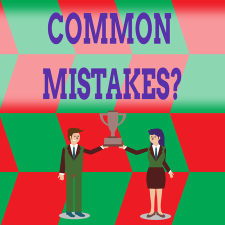 Writing note showing Common Mistakes Question. Business concept for repeat act or judgement misguided making something wrong Man and Woman Business Suit Holding Championship Trophy Cup