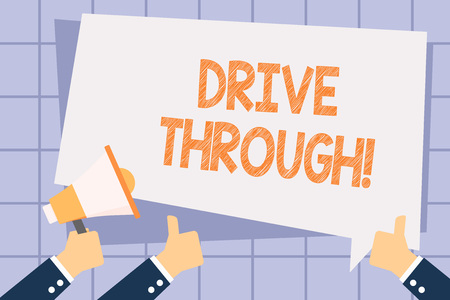 Writing note showing Drive Through. Business concept for place where you can get type of service by driving through it Hand Holding Megaphone and Gesturing Thumbs Up Text Balloon Stock Photo