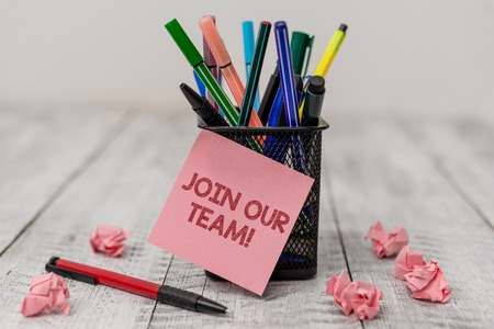 Conceptual hand writing showing Join Our Team. Concept meaning invite someone to work together for particular purpose target Writing equipment and paper scrap with blank sheets on wooden desk