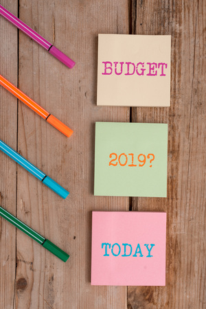 Handwriting text Budget 2019 Question. Conceptual photo estimate of income and expenditure for next year Note papers and stationary placed sideways on top of softhued backdrop