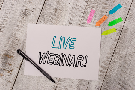 Handwriting text Live Webinar. Conceptual photo presentation lecture or seminar transmitted over Web Plain note paper and line arrow stickers with pen above the wooden table