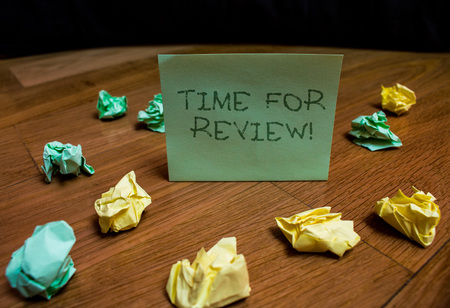 Handwriting text Time For Review. Conceptual photo formal assessment of something with intention instituting change Colored small wrinkled paper balls standing square note lying wooden table