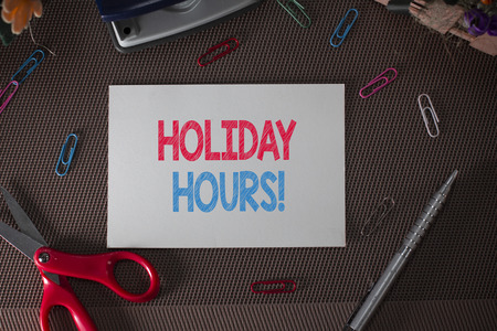 Conceptual hand writing showing Holiday Hours. Concept meaning Overtime work on for employees under flexible work schedules