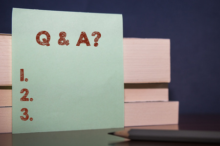 Handwriting text Q And A Question. Conceptual photo in which demonstrating asks questions and another one answers them Close up three wooden different sizes rectangle boxes paper sheet pencil