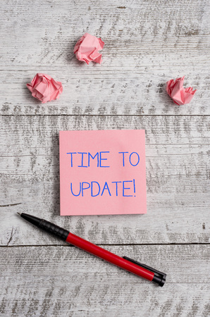Conceptual hand writing showing Time To Update. Concept meaning act updating something someone or updated version program Stationary and paper scraps with sheets on the wooden desk