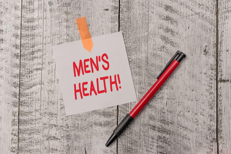 Text sign showing Men S Health. Business photo text state of complete physical mental and social well being by analysis One plain blank paper sheet and a pen attached with wooden textured table