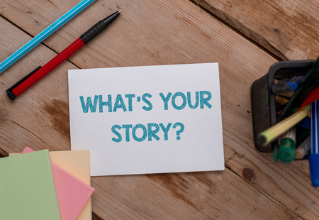 Conceptual hand writing showing What S Your Story Question. Concept meaning asking demonstrating about his past life actions events Note papers and stationary placed sideways softhued backdrop