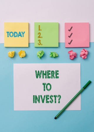 Conceptual hand writing showing Where To Invest Question. Concept meaning asking about where put money into financial schemes or shares Stationary placed sideways on top of the softhued backdrop