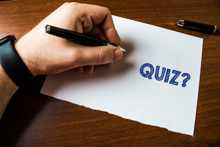 Conceptual hand writing showing Quiz Question. Concept meaning test of knowledge as competition between individuals or teams Man left hand watch paper ballpoint Pen cap lying wooden table