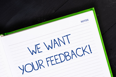 Text sign showing We Want Your Feedback. Business photo showcasing criticism given someone say can be done for improvement Close up view corner blank page notebook. Writing ideas projects goals