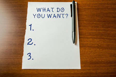 Handwriting text What Do You Want Question. Conceptual photo say or write in order to ask demonstrating about something Upper view blank stationary paper lying wooden table pen. Writing essay