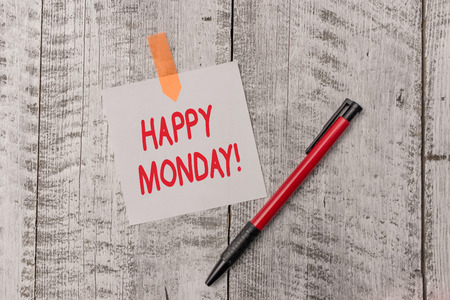 Text sign showing Happy Monday. Business photo text telling that demonstrating order to wish him great new week One plain blank paper sheet and a pen attached with wooden textured table