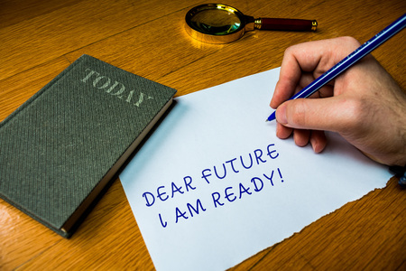 Conceptual hand writing showing Dear Future I Am Ready. Concept meaning suitable state for action or situation being fully prepared Man writing document wood table magnifying glass electronic device 스톡 콘텐츠