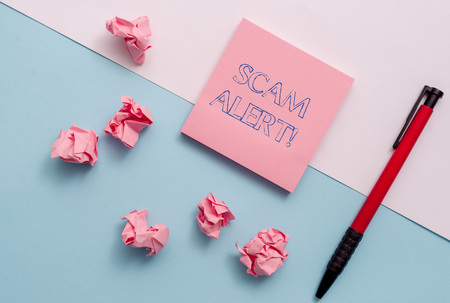 Conceptual hand writing showing Scam Alert. Concept meaning fraudulently obtain money from victim by persuading him Stationary placed sideways on top of the softhued backdrop Stock Photo
