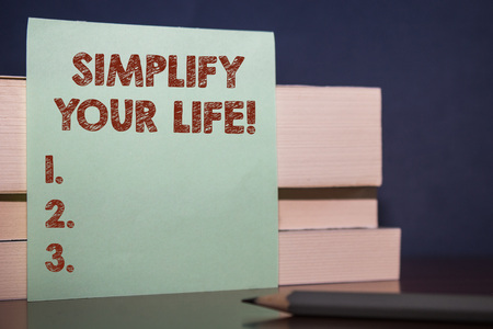 Handwriting text Simplify Your Life. Conceptual photo focused on important and let someone else worry about less ones Close up three wooden different sizes rectangle boxes paper sheet pencil