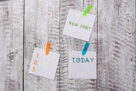 Conceptual hand writing showing New Job Question. Concept meaning formal meeting which someone asked find out if they are suitable Plentiful of plain paper sheet attached with wooden textured table