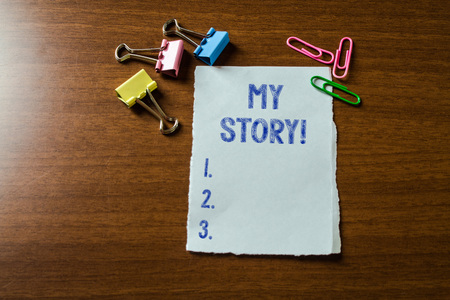Handwriting text writing My Story. Conceptual photo your past life events actions or choices you made Blank stationary paper set three colored clips binders lying wooden table