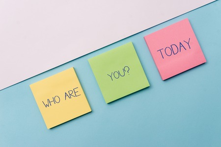 Text sign showing Who Are You Question. Business photo showcasing asking about someone identity or demonstratingal information Pastel colour note papers placed sideways on the of softhued backdrop
