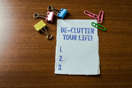 Handwriting text writing De Clutter Your Life. Conceptual photo remove unnecessary items from untidy or overcrowded places Blank stationary paper set three colored clips binders lying wooden table
