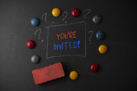 Writing note showing You Re Invited. Business concept for make a polite friendly request to someone go somewhere