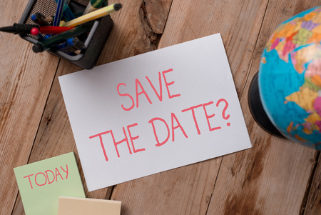 Writing note showing Save The Date question. Business concept for asking someone to remember specific day or time Writing equipments and sheets with artificial globe on the wooden desk Фото со стока