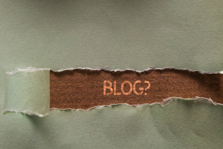 Word writing text Blog question. Business photo showcasing regularly updated website web page run by individual Long hole sheet blank paper wrapped paper tear. Wooden table background