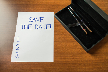 Conceptual hand writing showing Save The Date. Concept meaning remember not schedule anything else on this day Top view stationary lying wooden table case ball point set Stockfoto
