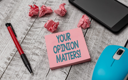 Text sign showing Your Opinion Matters. Business photo showcasing show you do not agree with something that just been said Writing equipment and paper plus scraps with gadgets on the wooden desk