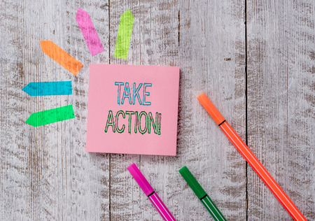Text sign showing Take Action. Business photo text do something official or concerted to achieve aim with problem Plain note paper and line arrow stickers on the top of wooden table desk