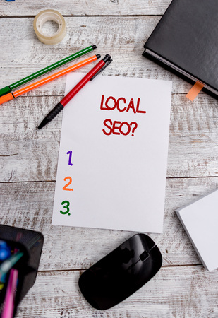 Conceptual hand writing showing Local Seoquestion. Concept meaning incredibly effective way to market your local business online Stationary and computer stuff pen with paper sheets on desk