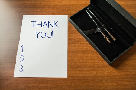 Conceptual hand writing showing Thank You. Concept meaning polite expression used when acknowledging gift service compliment Top view stationary lying wooden table case ball point set Stockfoto