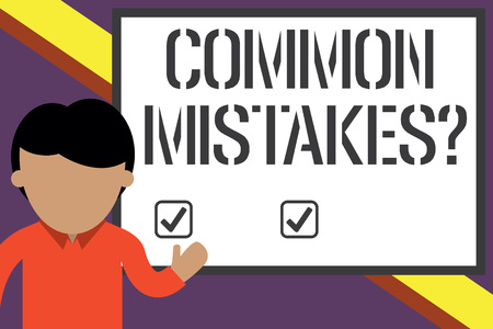Writing note showing Common Mistakes Question. Business concept for repeat act or judgement misguided making something wrong Young man standing in front whiteboard pointing to project. photo Art
