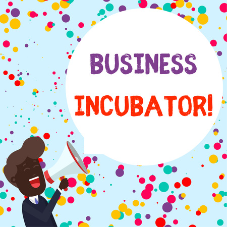 Writing note showing Business Incubator. Business concept for company that helps new and startup companies to develop Young Man Shouting in Megaphone Floating Round Speech Bubble