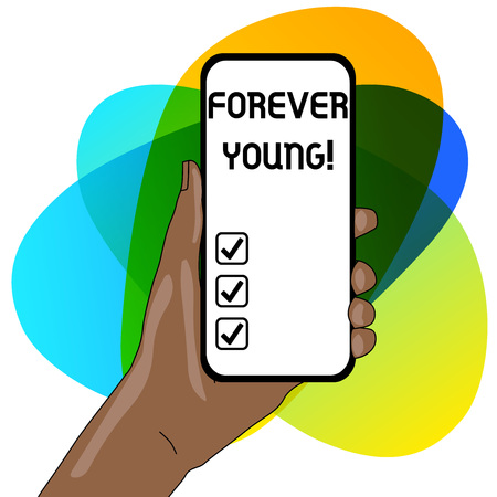 Word writing text Forever Young. Business photo showcasing mindset of a being fresh and carefree no matter the age Closeup of Smartphone Device Held in Hand with Empty Screen and Text Space 版權商用圖片