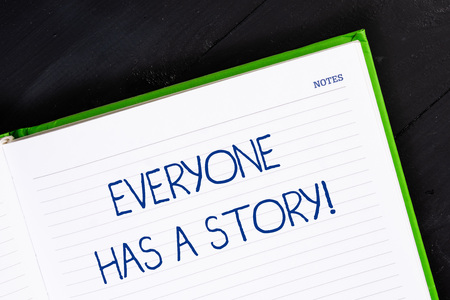 Text sign showing Everyone Has A Story. Business photo showcasing account of past events in someones life or career Close up view corner blank page notebook. Writing ideas projects goals