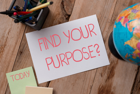 Writing note showing Find Your Purpose question. Business concept for reason for something is done or for which exists Writing equipments and sheets with artificial globe on the wooden desk