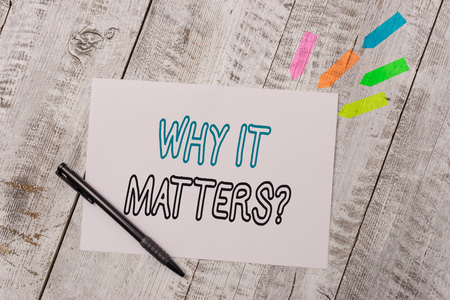 Handwriting text Why It Matters Question. Conceptual photo most important thing to be done when involved in situation Plain note paper and line arrow stickers with pen above the wooden table