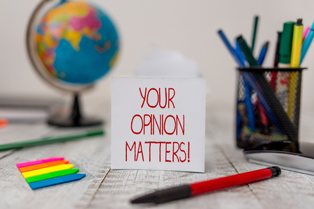 Text sign showing Your Opinion Matters. Business photo text show you do not agree with something that just been said Stationary and paper sheets plus small arrows with globe on the wooden desk