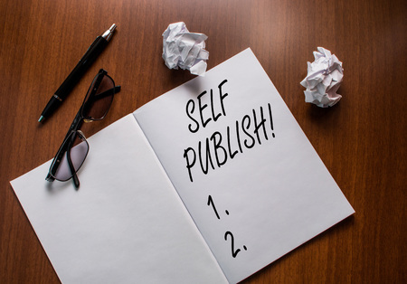 Conceptual hand writing showing Self Publish. Concept meaning writer publish piece of ones work independently at own expense Notebook small wrinkled paper balls reading glasses wooden table Stock fotó