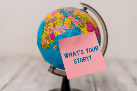 Word writing text What S Is Your Story question. Business photo showcasing being asked by someone about my own journey from beginning till now Plain note paper sticked to a mini miniature of the world on the wooden table