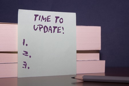 Text sign showing Time To Update. Business photo showcasing act updating something someone or updated version program Close up three wooden different sizes rectangle boxes paper sheet pencil